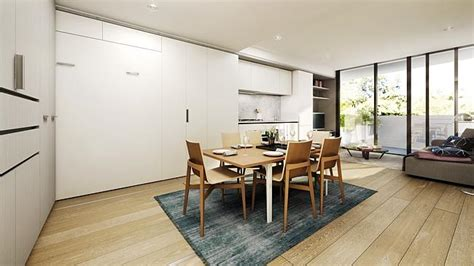 convertible units are set to be the future of apartment once the bedroom wall is moved there is a kitchen dining