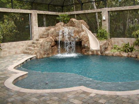 free form pool with slide all aqua pools rock wall
