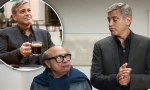 nespresso commercial actress danny devito george clooney takes danny devito under his wing for