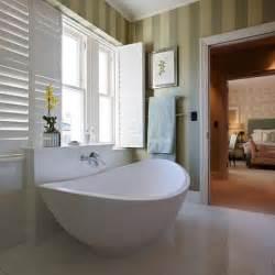 grey designer bathroom suite white en suite bathroom with green stripe wallpaper