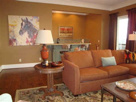 casual den with rust and teal color scheme panoply interior design panoply projects