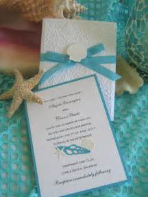 seashell and lace wedding invitation