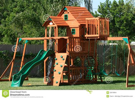 wooden playhouse with swing and slide play house swings and slide stock images image 22978964