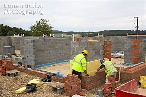 house website a026 00974 bricklayers on a house building site englan construction photography