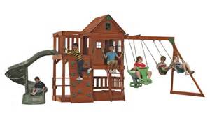 swing on the spiral patriot backyard cedar playset for kids backyard discovery