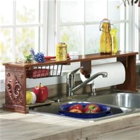 the sink shelf with paper towel holder the sink shelf fingerhut apartment small space