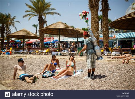 on the beach people on the beach eilat israel stock photo royalty