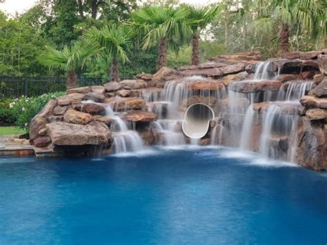 rock swimming pool pond waterfalls waterfall love all the rocks and waterfalls along with the tube