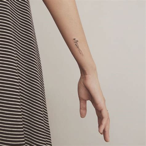 small tattoo placement the 25 best small arm tattoos ideas on