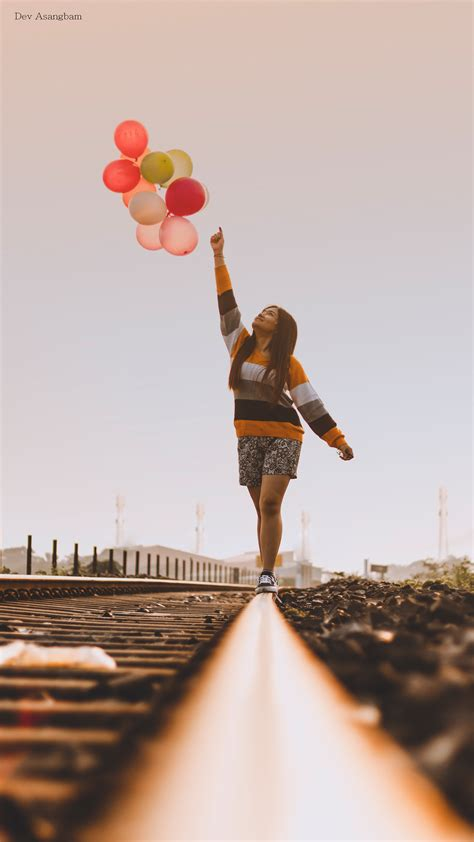happy girl balloons train track photography   ultra