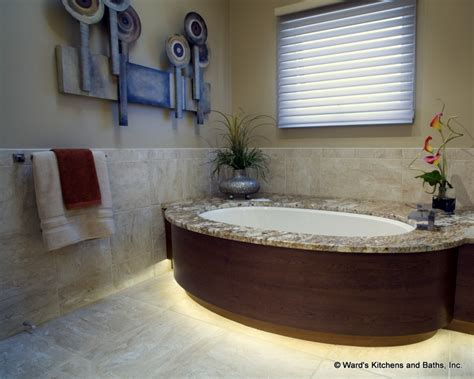 curved tub deck with toe space lighting granite tops with