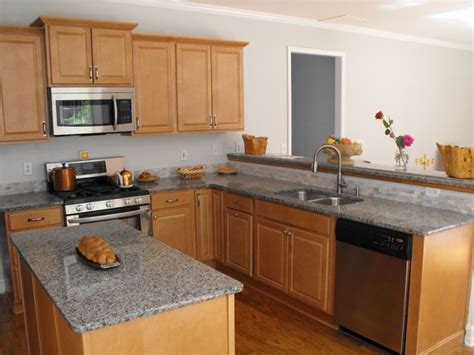 maple kitchen cabinets with granite countertops maple cabinets and a light grey granite countertop the