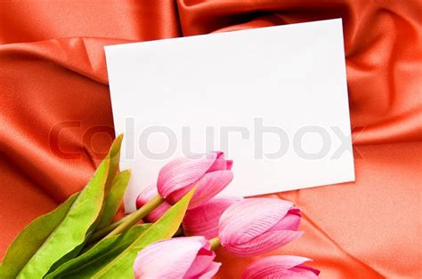 Flowers Box Satin Bloom Box envelope and flowers on the satin background stock photo