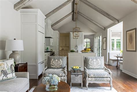 remodeled white kitchen  vaulted ceiling beams home