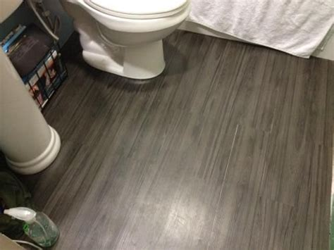 allure bathroom flooring trafficmaster allure 6 in x 36 in iron wood resilient