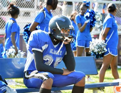 football player on bench the complicated issue of benching young athletes with