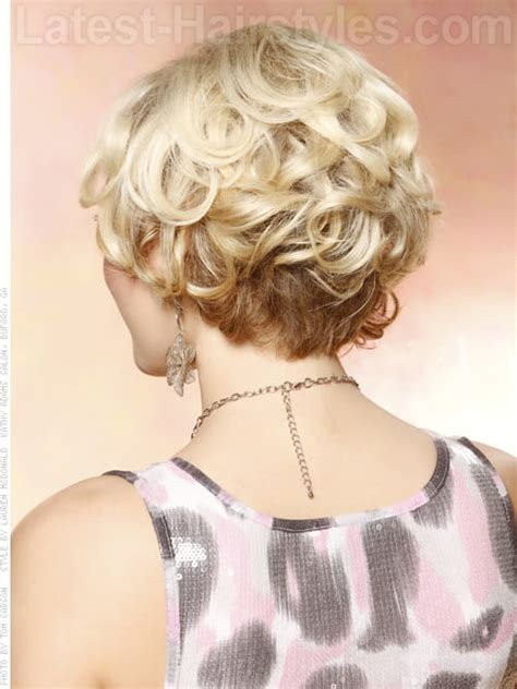 short hairhair straght on back curly on top short blonde layered style with lots of volume back view