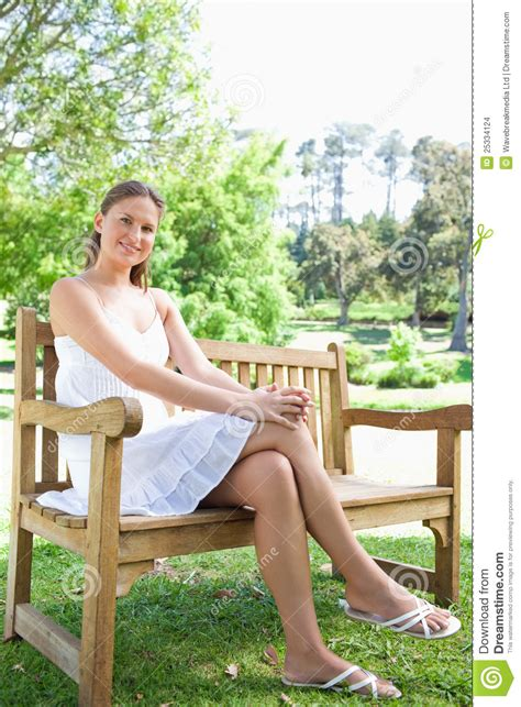 park bench legs stock photo woman sitting with legs crossed male models