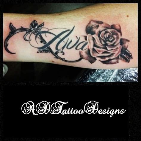 rose and writing tattoos a non outlined and vine with healed writing to