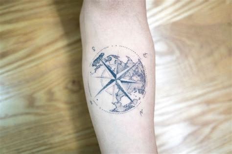 dotwork rose compass tattoo on left arm by daniel rozo dotwork tattoo compass and earth best tattoo ideas gallery