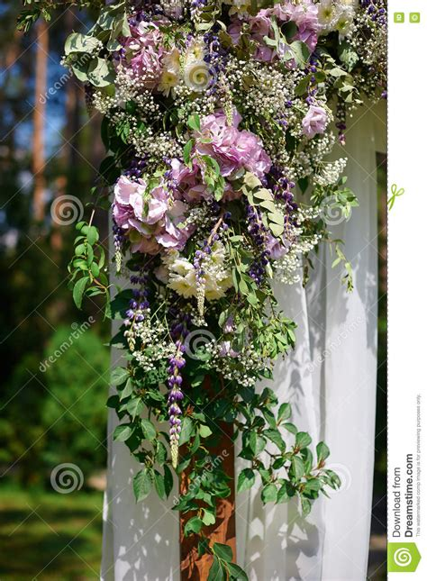 Wedding Arch Decorated With Flowers by Wedding Arch Decorated With Flowers And Glass Hanging