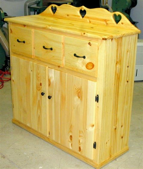 crafted country style storage cabinet by the plane
