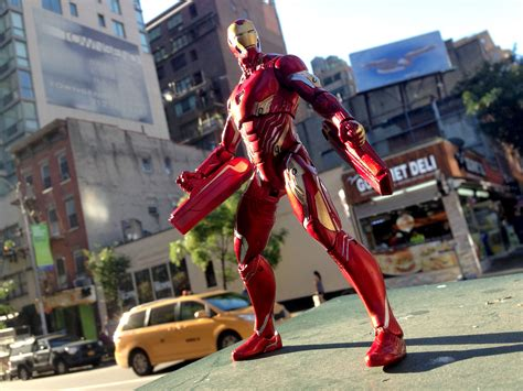 exclusive marvel select iron man figure brings infinity