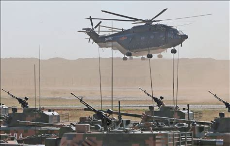President Xi Jinping Inspected A Field Parade At The