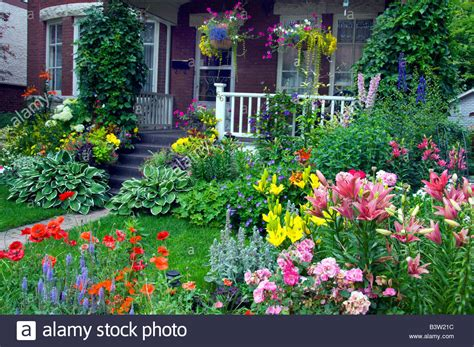 wolseley area home with decorative spring flowers in the front yard stock photo royalty free