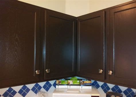 the color of these cabinets sherwin williams black bean 6006 was a prefect match for the