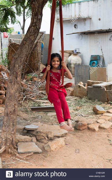 swinging india young indian village girl playing on a swing made from a