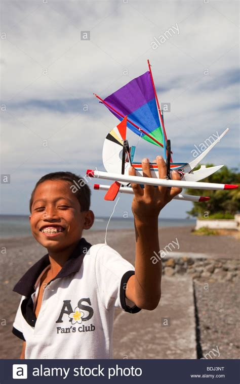 buy a gift boat trip indonesia bali amed child holding up hand made souvenir