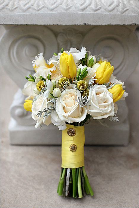 the yellow with green notice the buttons on the ribbon wedding flower