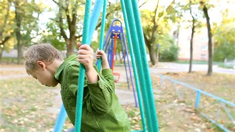 motion of a child on a swing is cute child on swing little boy rides on swing on children