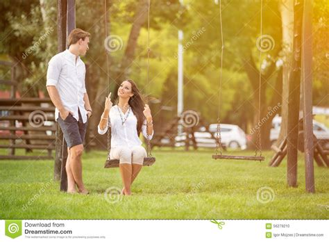 couples swing attractive in park on swing stock photo image