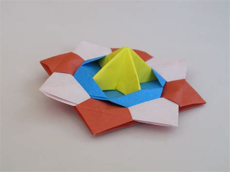 How To Make A Top Out Of Paper - origami how to make a spinning top