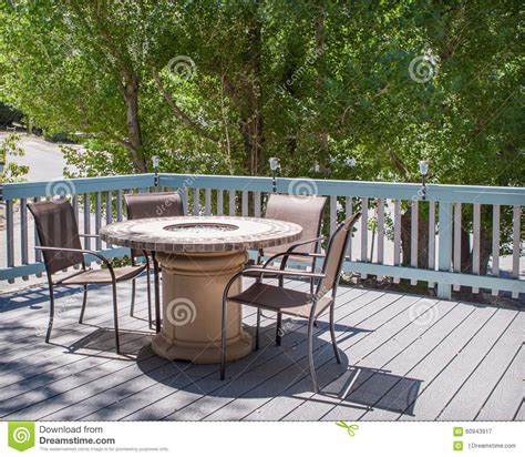 table with pit in middle patio table with pit and chairs on deck stock photo