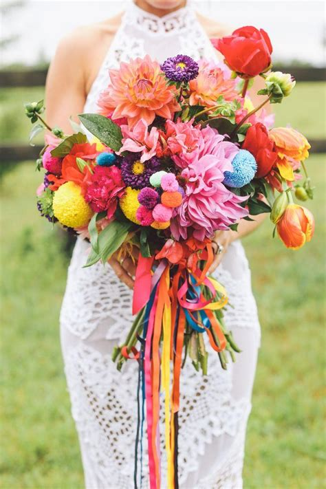 colorful wedding bohemian wedding colorful blossoms on the wedding aisle