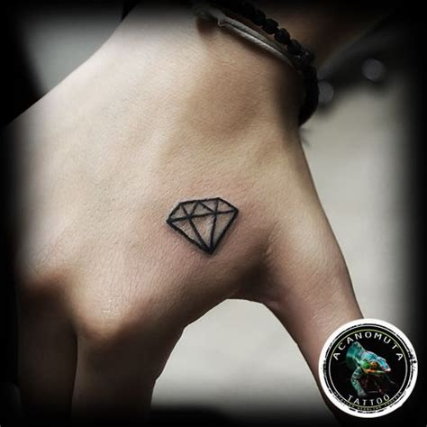 diamond tattoo on hand small on right