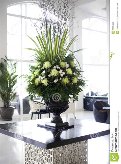 Modern American Kitchen Design by Beautiful Flower Arrangement In Large Foyer Royalty Free