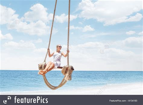 tropical swing picture of woman on tropical swing
