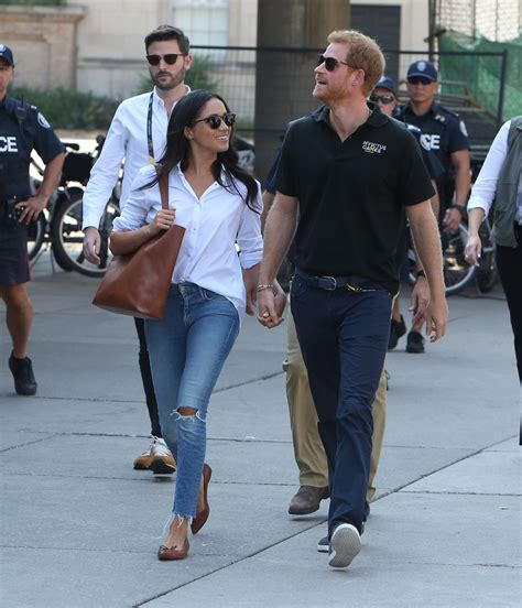 meghan harry prince harry and meghan markle hold hands at invictus