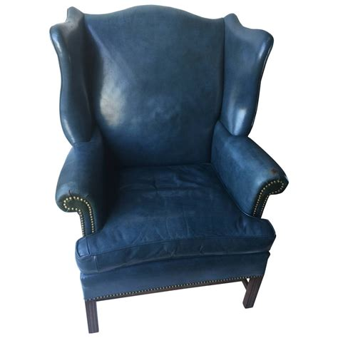 denim blue leather wingback chair and ottoman at 1stdibs