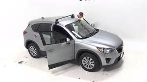 installation of a thule traverse roof rack on a 2015 mazda