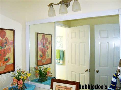 Add Trim To Bathroom Mirror How To Add Molding Around Your Bathroom Builder Grade Mirrors Debbiedoos