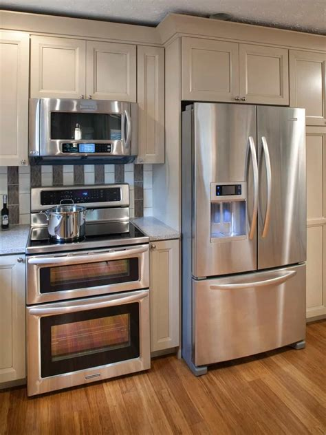Kitchen With Hardwood Floors And Stainless Appliances
