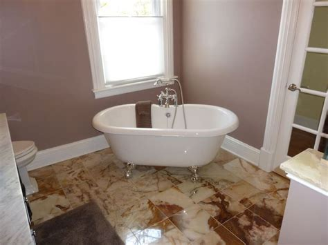 mauve bathroom claw foot tub marble tile floor mauve walls bathrooms