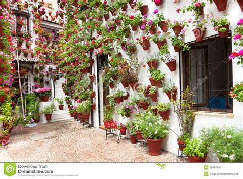 Spanish House Plans With Courtyard Spring Flowers Decoration Of Old House Patio Cordoba