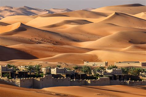 desert sand dunes town house oasis hd wallpaper