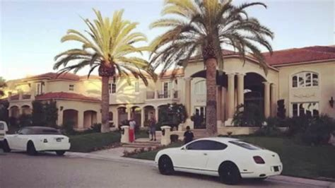 tyga yellow bentley tyga s white drophead rolls royce and bently parked at his